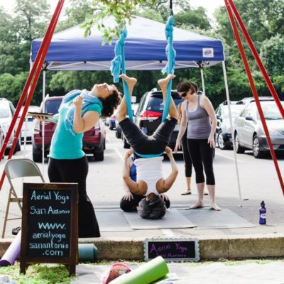Aerial Yoga San Antonio sharing their love of the hammock and a few favorite poses to Yoga Day participants. Photo by Stacey Anne Photography