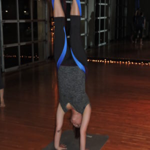 Using the aerial hammock, Jordan in a handstand.
