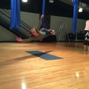 Cherise in flying swordfish pose.