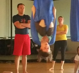 Anne demonstrates key safety points in aerial shoulderstand prep.